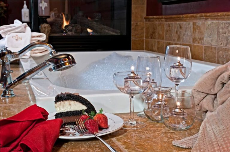 Spanish Suite Bath with Bubbles, cake, strawberries and wine glasses on the edge