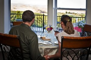 Young couple having wine in The Vine dining room